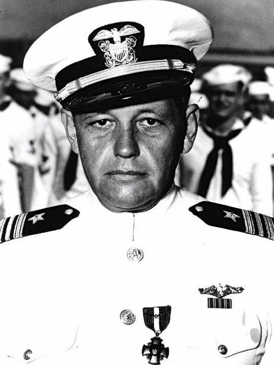 Lieutenant Commander William Brockman as he received the Navy Cross for heroism at Midway, Pearl Harbor, 7 November 1942. U.S. Navy.